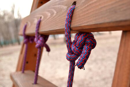 Knot on a colorful rope. Tools for climbing.
