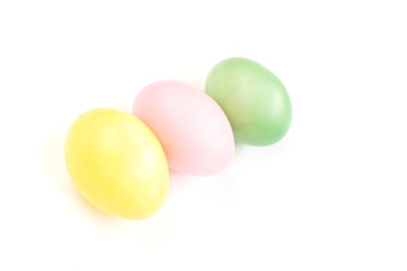 Colored  Easter eggs on white background photo