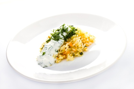 White rice with garlic sauce on a plate  on white background photo