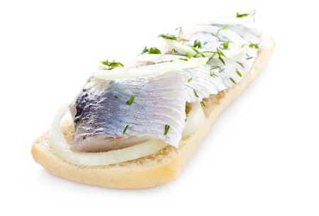 Sandwich with herring, onions and herbs, isolated photo
