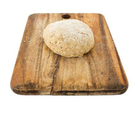 Raw ball of dough on wooden board isolated on white background photo