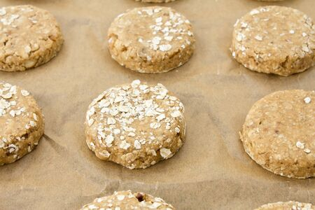 high calorie: Raw oatmeal cookie dough on a baking sheet with parchment