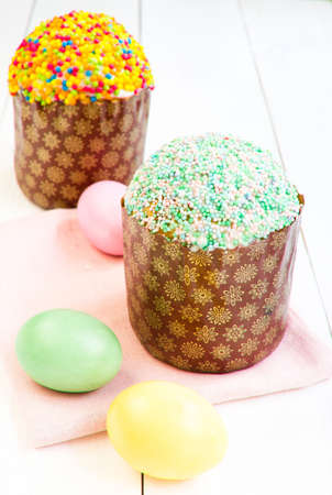 Fresh and tasty Easter cake and eggs on wooden background. photo