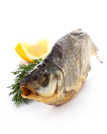 Dried tasty fish on a white background photo