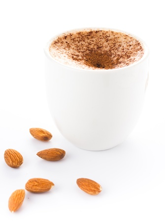 medium size: Medium size coffee with milk powdered with chocolate in a cup on a white background