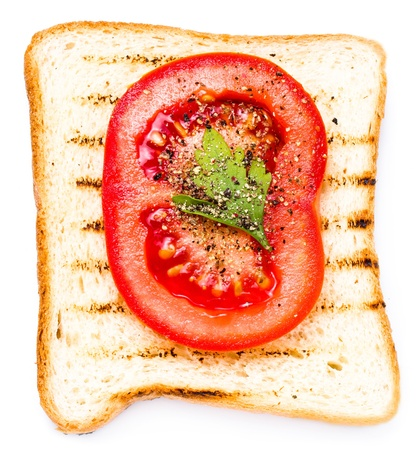 White bread toast with tomato. Isolated on white background, macro photo