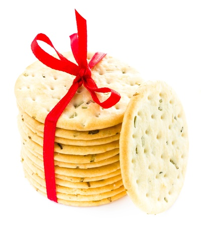 Sweet fresh cookies tied with red ribbon isolated on white background isolated on white, closeup photo