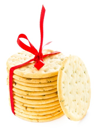 Christmas shortbread  wrapped with red ribbon fresh pastry cookies isolated on white background  photo