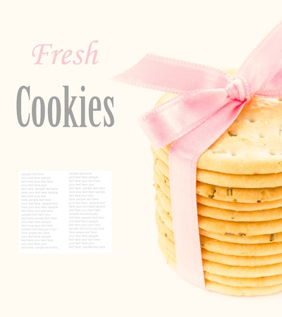 Cookies with pink ribbon isolated on white background photo