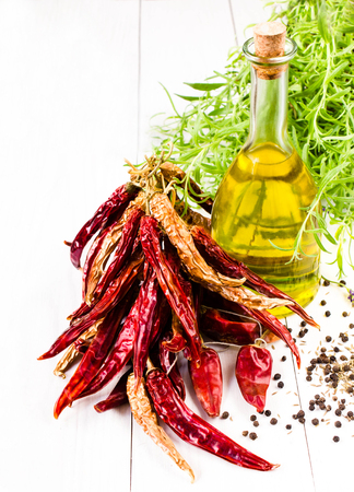 cooking oil: Olive oil bottle, herbs and vegetables on white background,  Stock Photo