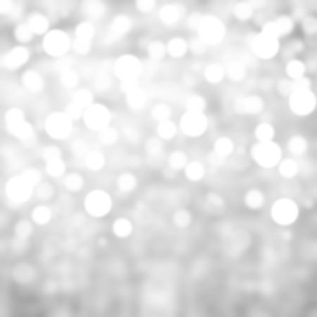 シルバー ライトお祝いクリスマス背景テクスチャ。抽象的なクリスマスおもしろがって明るい背景にボケ味デフォーカス ライト 写真素材