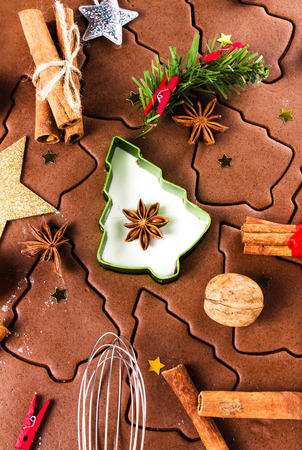Christmas Gingerbread baking, cookie cutters, spices and nuts. Christmas festive food, top view, closeup. photo