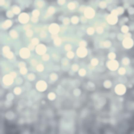 灰色ライトお祭りの背景。抽象的なクリスマスおもしろがって明るい背景にボケ味デフォーカス シルバー ライト 写真素材
