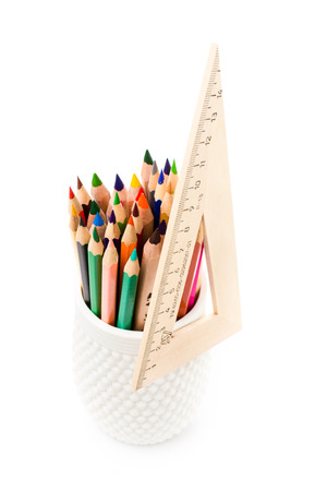 Back to school supplies with Color pencils in a cup and ruler.  photo
