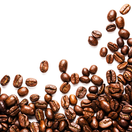 Roasted Coffee Beans  background texture isolated on white background with copy space for text, macro photo