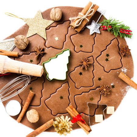 festive food: Christmas Gingerbread baking, cookie cutters, spices and nuts. Christmas festive food, top view, closeup.