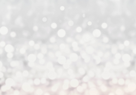 Light silver abstract Christmas background with glowing magic bokeh. Blurred christmas winter background