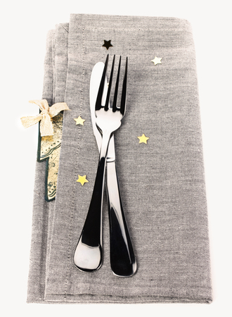 Table setting for Christmas with gold stars photo