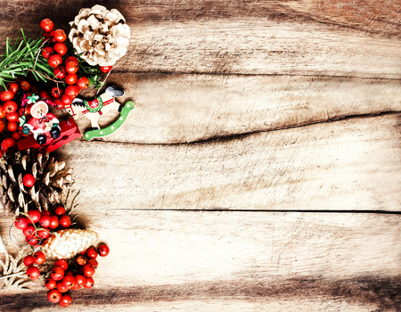 Vintage Christmas Decoration on natural wooden textured background  with copyspace. Christmas frame. photo