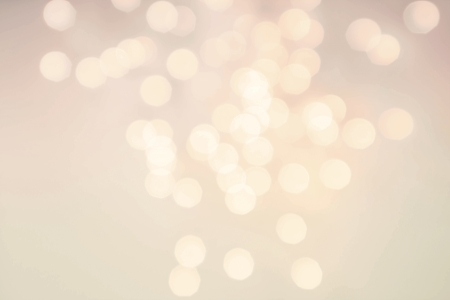 Glittery lights golden abstract Christmas background. Defocused Bokeh twinkling lights Vintage background.