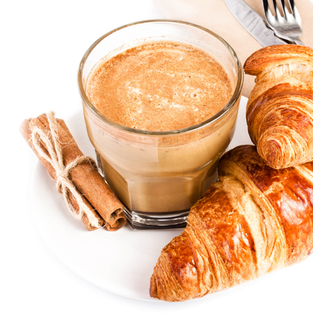 traditionally french: Coffee with milk and Croissants on white plate and linen napkin isolated on white background, closeup. Stock Photo