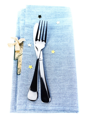 Table setting for Christmas with gold stars on blue festive napkin photo