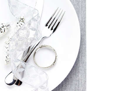 Festive table place setting with christmas decorations photo