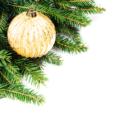 Christmas Fir Tree Border with  festive ornaments isolated on white background with copy space for text. Christmas tree branches border over white. photo