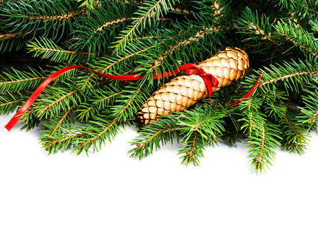 Christmas Frame with Fir Tree Branch and Christmas decoration isolated on white background. Christmas garland. Evergreen Border Design. photo