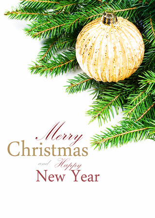 Christmas card with Fir Tree Branch and Christmas decoration  isolated on white background with copy space (with sample text) photo