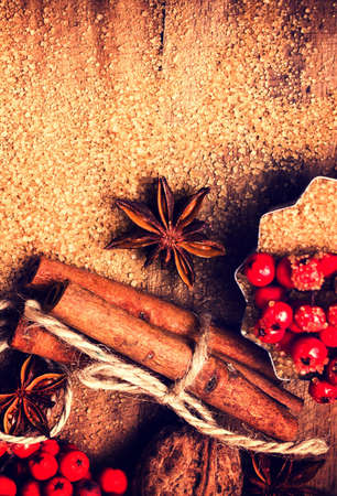 festive food: Cinnamon sticks,  Brown sugar and anise star on wooden table close up, still life. Festive Food background.