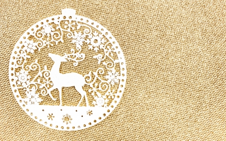 Elegant Gold Christmas background with white Christmas Ornaments. Holiday  Glittering textured background with  copy space. Golden Christmas Card. photo