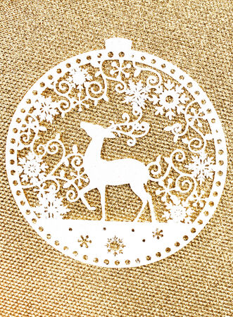 gold textured background: Elegant Gold Christmas background with white Christmas Ornaments. Holiday  Glittering textured background with  copy space. Golden Christmas Card.