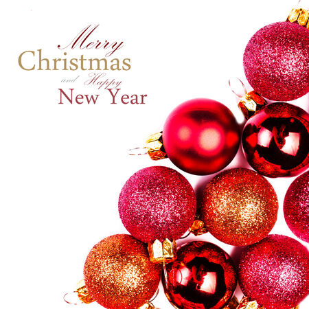 Christmas card with Christmas Ornaments isolated on white backhrouns. Festive glittering red balls close up with copy space for greeting text. photo