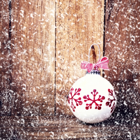 Christmas Decoration Over Wooden Background With Snowflakes Vintage Card White Festive Bauble And