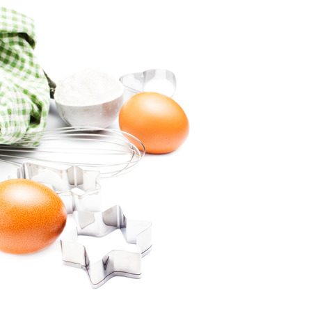 Eggs and flour for baking cookies isolated on white background. photo