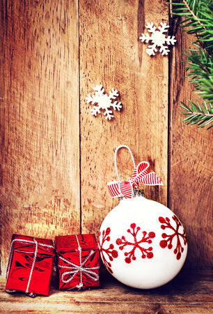 old fashioned christmas: Old Fashioned Christmas ornaments  over wooden background  with fir tree branch and festive decorations. Vintage Christmas Card with  copy space for greeting text.