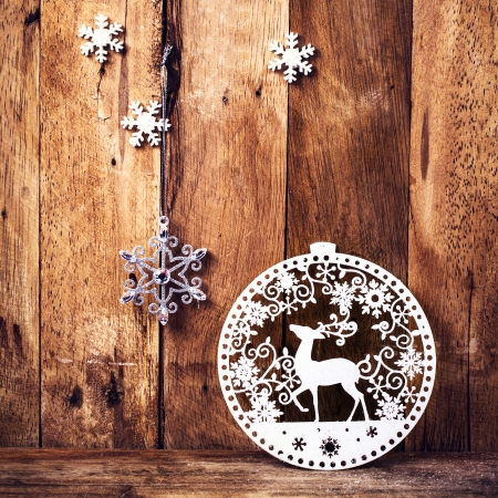 Christmas background with festive decorations on old wooden wall. Old fashioned Christmas Decoration with copyspace.