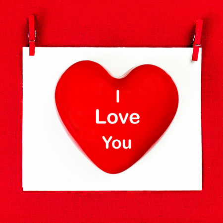 i love you:  Valentines Day background with greeting text I LOVE YOU. Red Heart on a white paper card. Valentines Card.