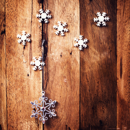 old fashioned christmas: Christmas background with festive ornaments and snowflakes on old  wooden wall. Old fashioned Christmas Decoration with copy space. Stock Photo