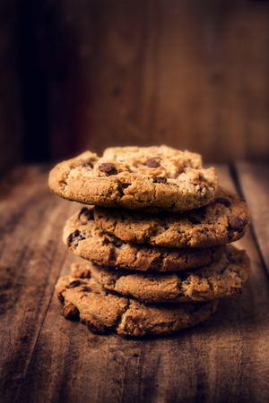 Chocolate cookies on wooden table. Stacked Chocolate chip cookies shot  closeup Banco de Imagens