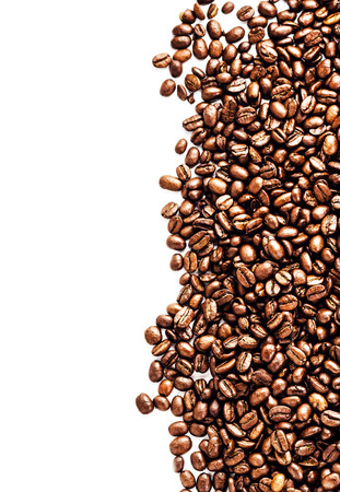 Closeup of coffee beans background. Roasted Coffee Beans background texture isolated on white background frame with copy space for text Banco de Imagens