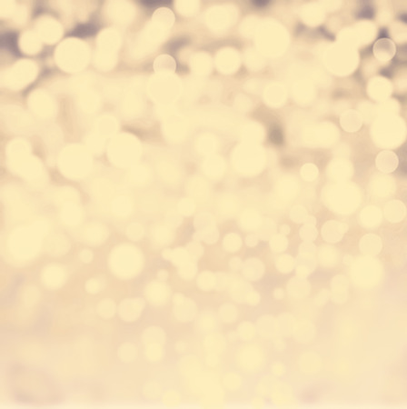 Abstract bokeh lights vintage background with defocused golden lights. De focussed background with sparkles, fine art, soft focus, greeting holiday card, festive frame, magic lights, shiny wallpaper photo