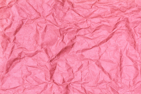 Crumpled recycled paper background texture pink  color.  Paper for package.  Banco de Imagens