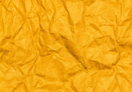 craft paper: Crumpled yellow paper texture background. Craft paper sheet, vivid color. Texture of crumpled paper. Stock Photo
