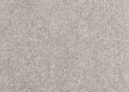 Recycled paper texture closeup background, grey color. photo