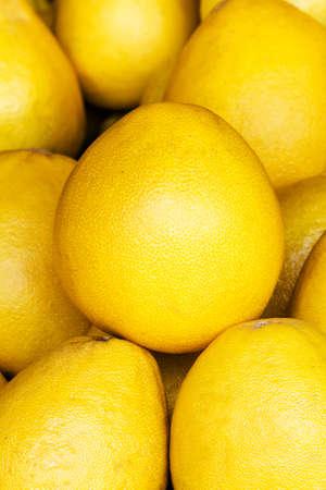 Pomelo fruit background. Yellow Pomelo fruit on a market closeup.   photo