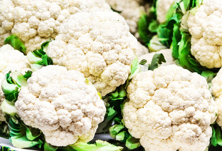 Fresh raw cauliflower on market close up.  Cauliflower  background. Food background.  photo