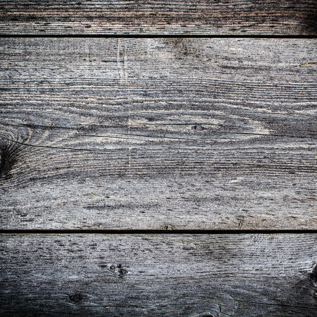 Dark grey wooden textured background closeup. Gray Wood background square format. photo