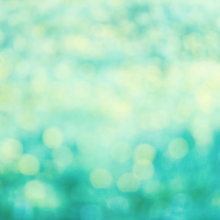 Defocused Bokeh twinkling lights Vintage background. Festive background with bokeh and bright white and cyan  lights. Reklamní fotografie - 29552845